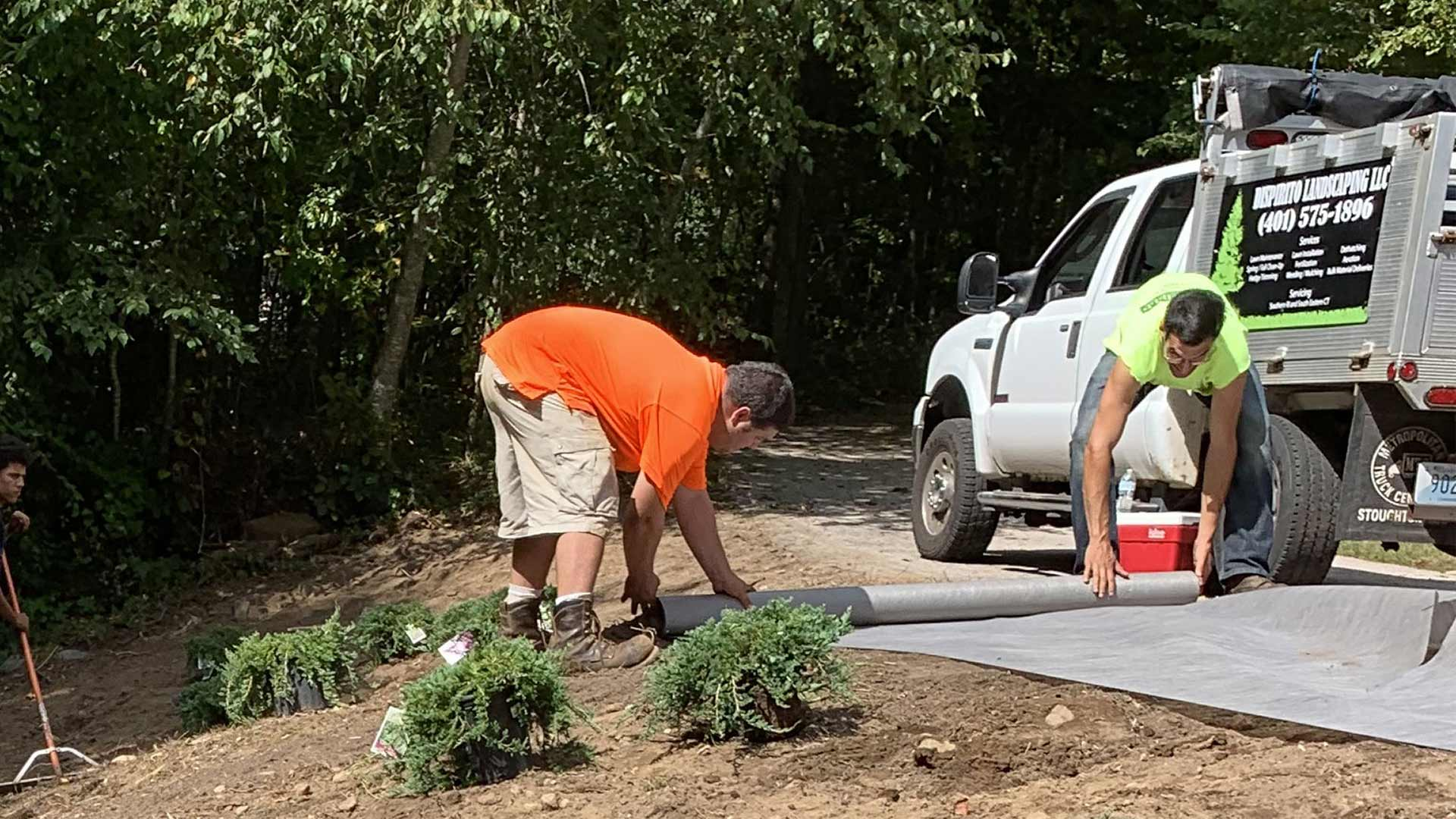 DiSpirito Landscaping LLC employees working on landscaping projects in Westerly, RI.