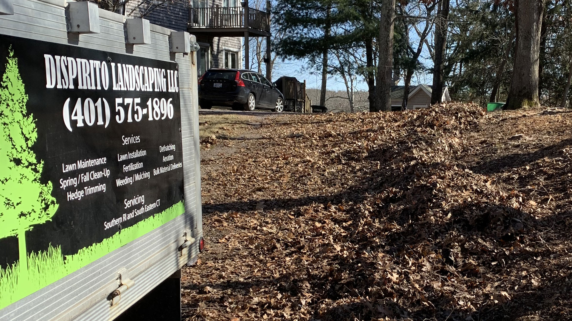 DiSpirito Landscaping LLC work trailer at a Westerly, RI home property.